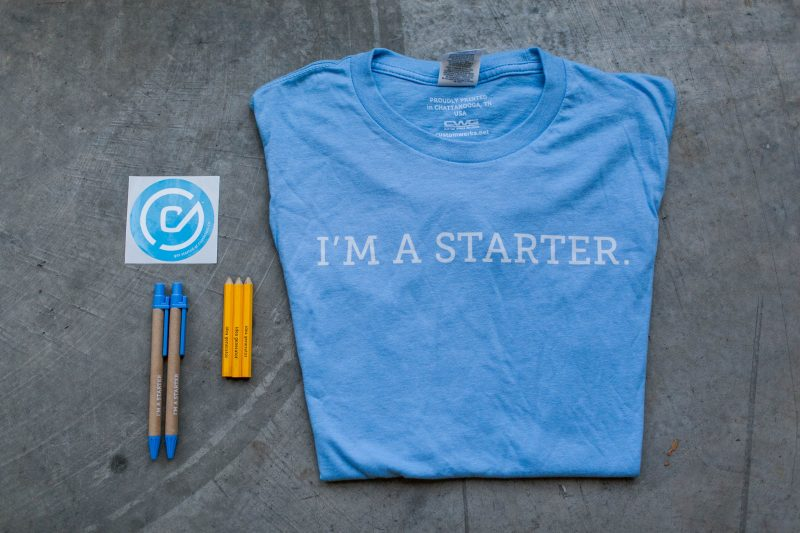 Picture of costarters gear. Pencils and shirts.