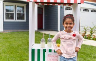 Girl Running Homemade Lemonade Stand