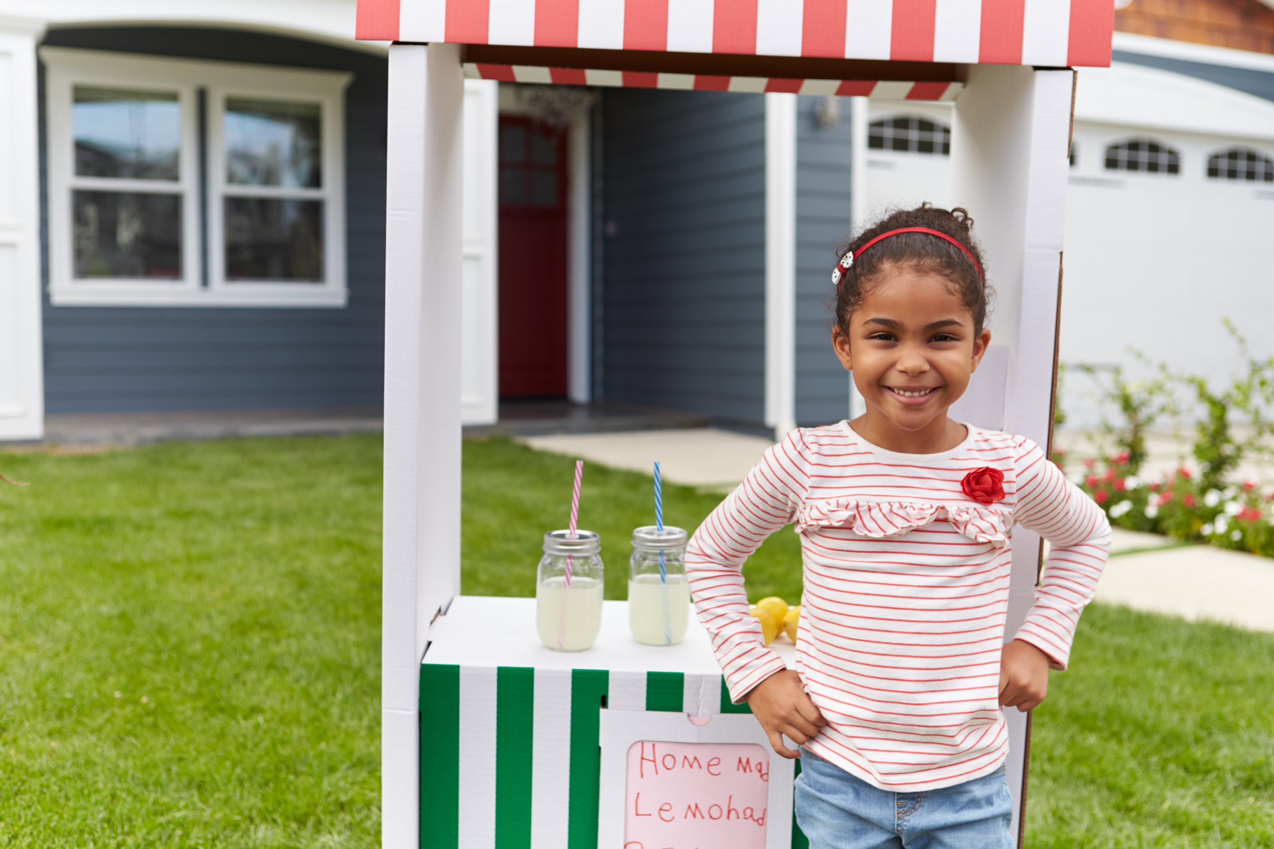 Girl Running Homemade Lemonade Stand